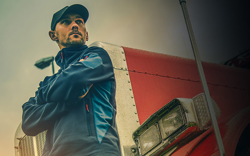 Man posing against truck