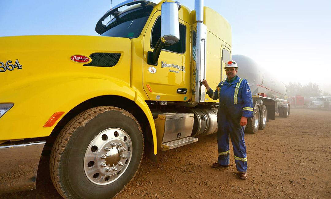Hofmann Trucking LLC truck, tank, and driver photo